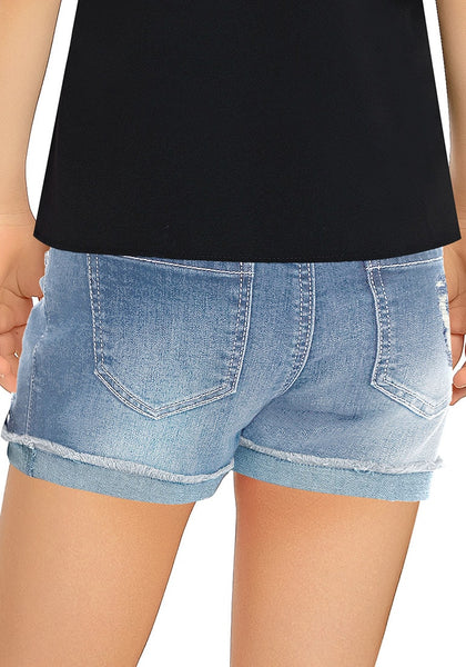 Back view of model wearing faded blue cuffed hem ripped girls' denim shorts