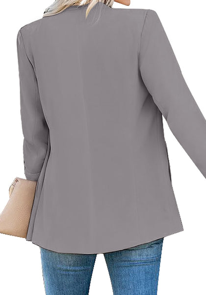 Back view of model wearing grey open-front side pockets blazer