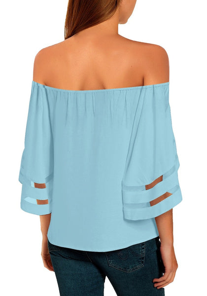 Back view of model wearing light blue 3-4 bell mesh panel sleeves tie-front off-shoulder top