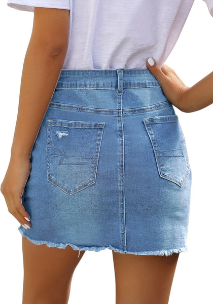 Back view of model wearing light blue distressed frayed hem denim mini skirt