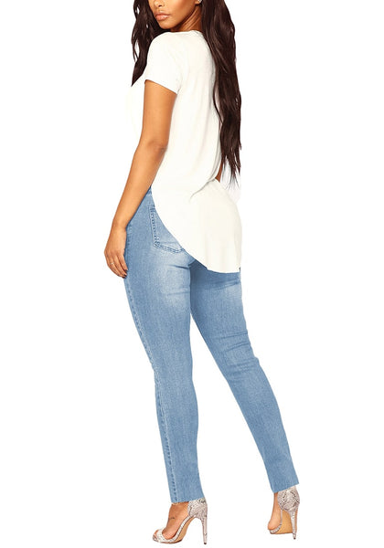 Back view of model wearing light blue drawstring-waist washout ripped skinny jeans