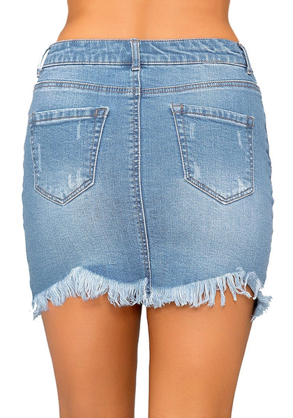 Back view of model wearing light blue frayed raw hem buttons denim mini skirt