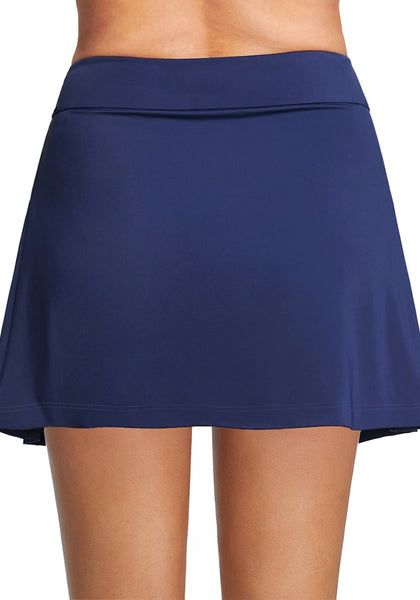 Back view of model wearing navy blue pleated side mid-waist swim skirt