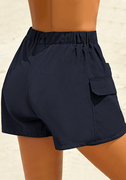 Back view of model wearing navy elastic-waist side pockets lace-up board shorts