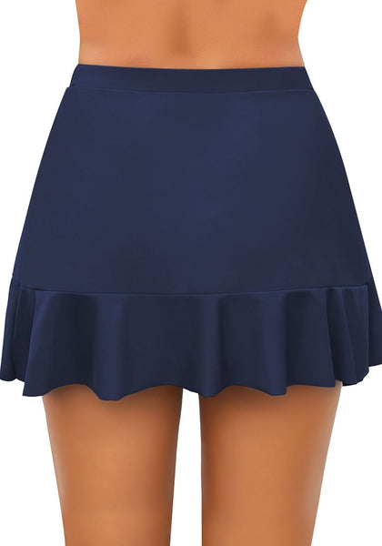 Back view of model wearing navy high-waist tulip hem ruffle swim skirt
