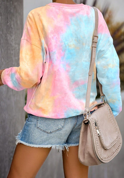 Back view of model wearing pink and yellow tie-dye drop shoulder pullover sweater