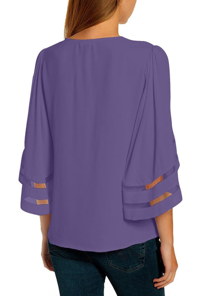 Back view of model wearing purple 34 bell mesh panel sleeves V-neckline loose top