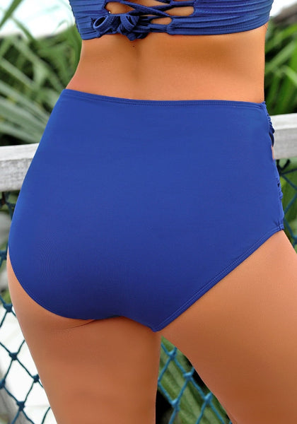 Back view of model wearing royal blue crisscross-waist cutout ruched bikini bottom
