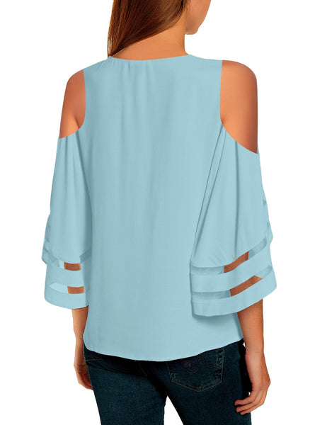 Back view of model wearing sky blue 3-4 bell mesh panel sleeves cold-shoulder loose top