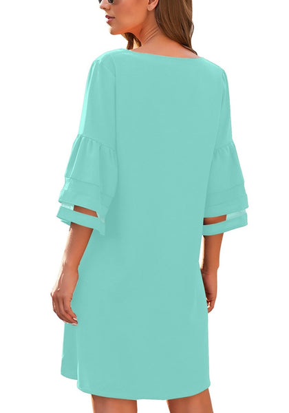 Back view of model wearing sky blue 3-4 mesh sleeves V-neck mini shift dress