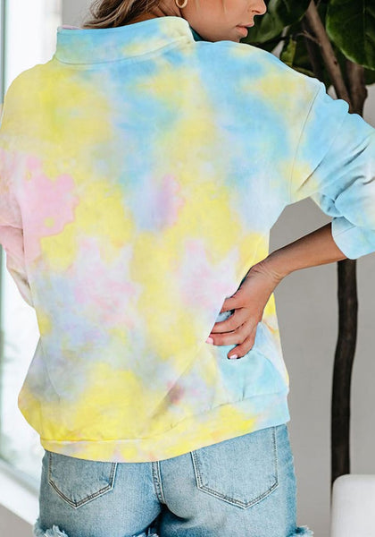 Back view of model wearing sky blue stand collar half-zip tie-dye pullover sweatshirt