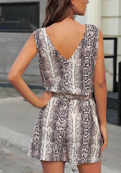 Back view of model wearing snake pattern V-neck sleeveless belted romper