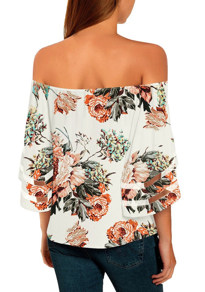 Back view of model wearing white 3-4 bell mesh panel sleeves tie-front off-shoulder floral top