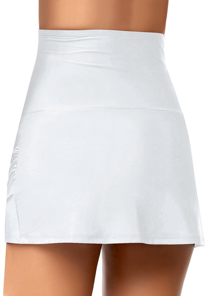 Back view of model wearing white tulip hem high waist ruched swim skirt