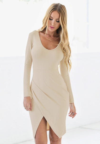 Beaty model in apricot draped wrap dress