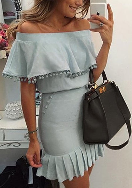 Beautiful lady taking a selfie in light blue ruffled off-shoulder pompom dress