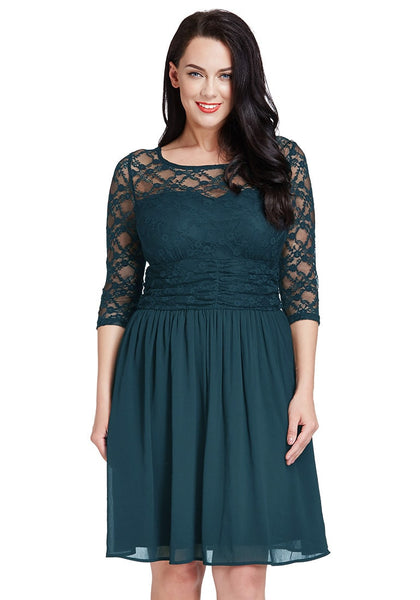 Beautiful model poses wearing peacock lace crop-sleeves skater dress