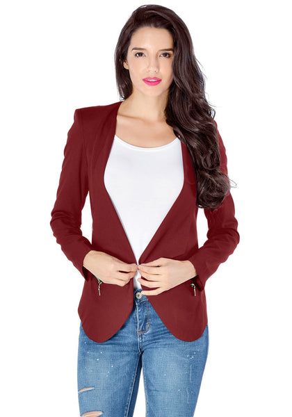 Beautiful model wearing burgundy draped blazer