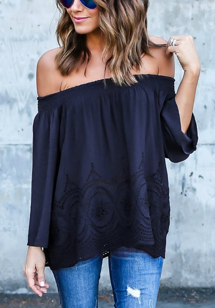 Beautiful model wearing navy blue off-shoulder hollow out hem top