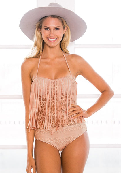 Beauty girl in pink lace fringed halter swimsuit