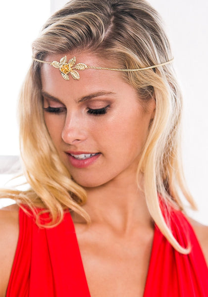 Beauty lady wearing gold rose boho headpiece