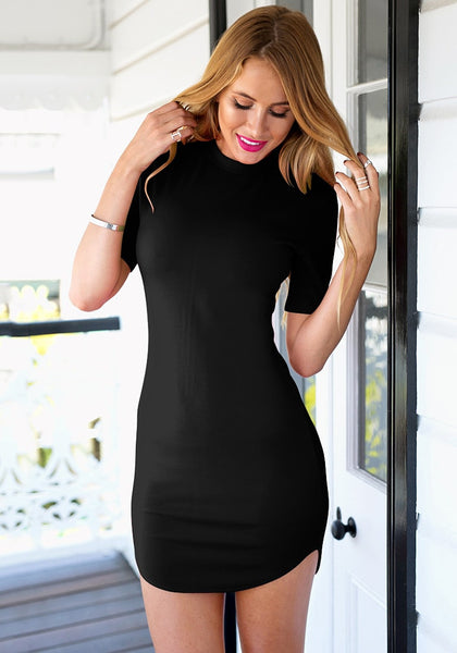Beauty model in black curved-hem bodycon dress
