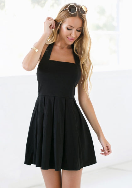 Beauty model in black halter skater dress