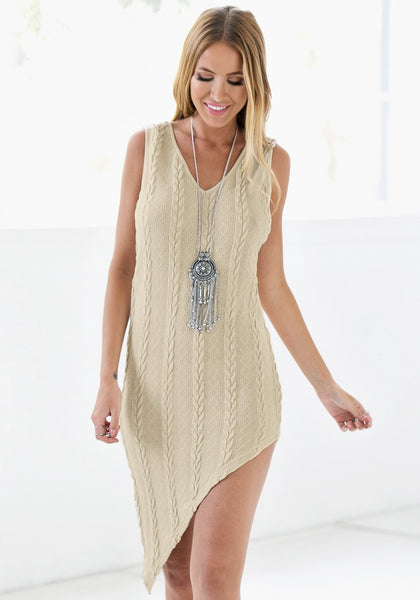 Beauty model wearing braided cable knit asymmetrical dress