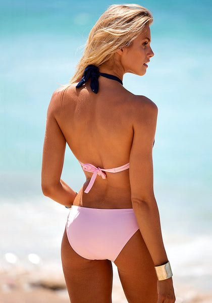 Back view of model in pink & navy bandeau bikini set