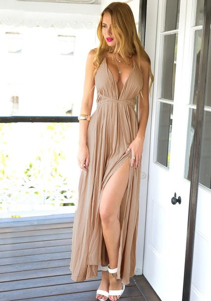 Bodacious model in cameo color strappy plunge dress