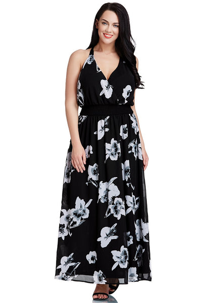 Brunette lady is wearing black floral-printed plunge maxi dress
