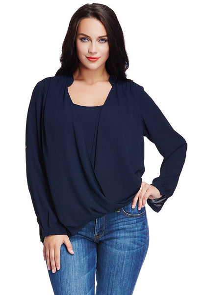 Brunette model poses in plus size navy blue Mandarin collar surplice shirt with one hand on hip