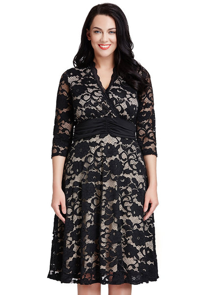 Brunette model wearing plus size apricot lace surpliced ruched-waist dress