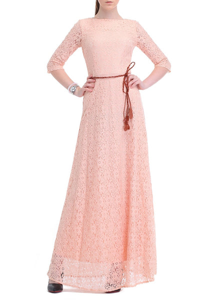 Brunette posing in a pink maxi lace dress