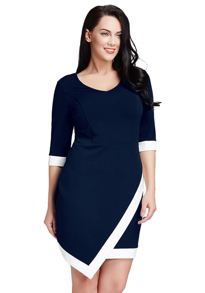 Brunette woman is wearing plus size navy asymmetric wrap bodycon dress
