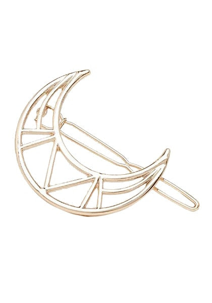Close-up of gold crescent-moon hair clip