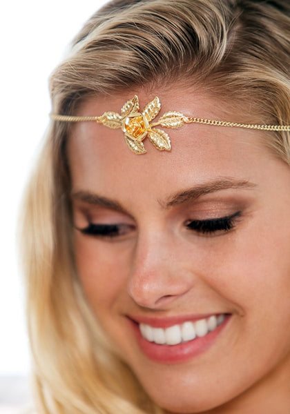 Close-up of model wearing gold rose boho headpiece
