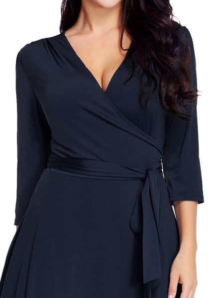 Close-up shot of model wearing plus size navy high-low wrap skater dress