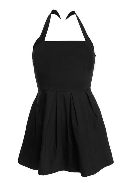 Close-up view of black halter skater dress