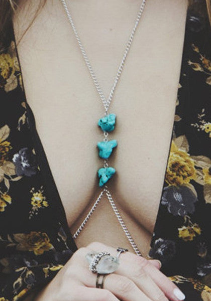 Close-up view of silver turquoise bodychain