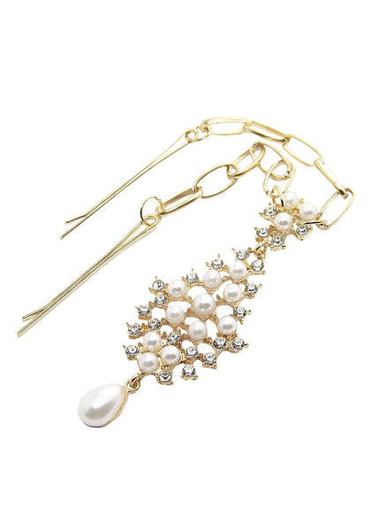 Close angled shot of gold pearl and rhinestone bindi headpiece