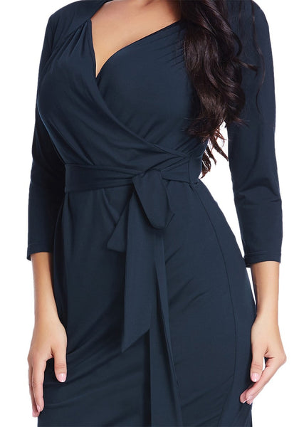 Close up front shot of model in plus size navy sweetheart wrap midi dress