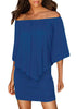 Close up front shot of woman in blue off-shoulder layered mini dress
