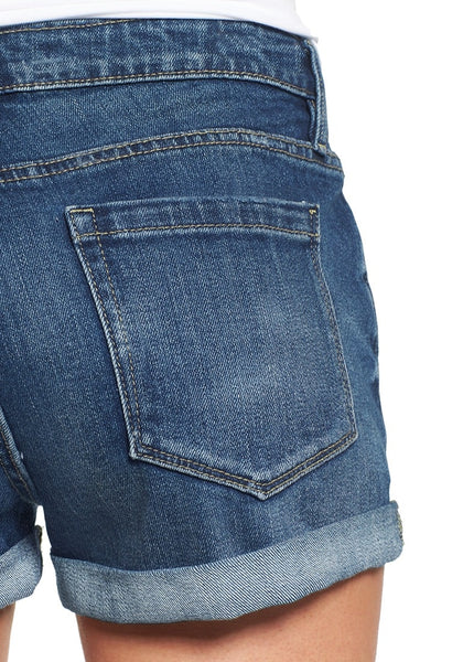 Close up shot of blue roll-over hem button-up distressed denim shorts