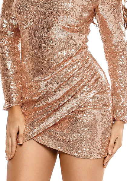 Close up shot of lady wearing champagne plunge-neck sequin dress
