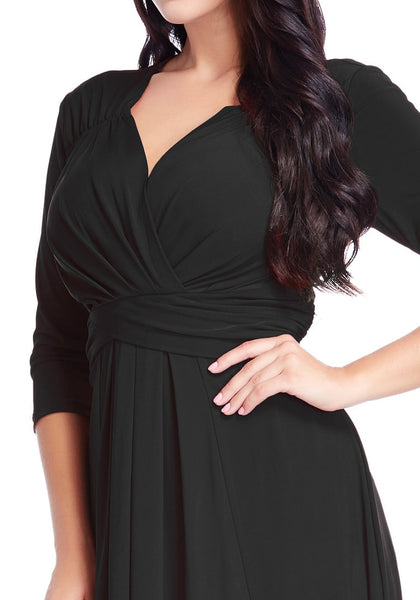 Close up shot of model in black ruched high-low dress showing front details