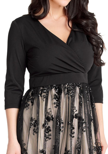 Close up shot of model in plus size black mesh floral sequin maxi  skater dress