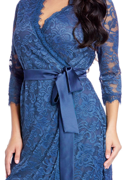 Close up shot of model in plus size blue lace crop sleeves wrap dress