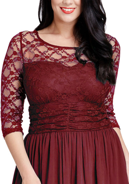 Close up shot of model in plus size burgundy lace crop-sleeves skater dress