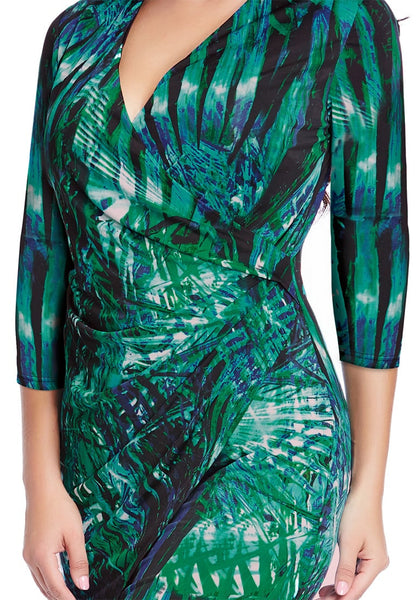 Close up shot of model in plus size green leaf-printed midi wrap dress